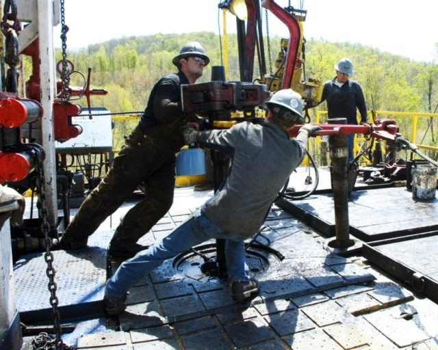 In this April 23, 2010, file photo, workers move a section of well casing into place at a Chesapeake Energy natural gas well site near Burlington, Pa., in Bradford County. Chesapeake Energy, a shale drilling pioneer that helped to turn the United States into a global energy powerhouse, has filed …