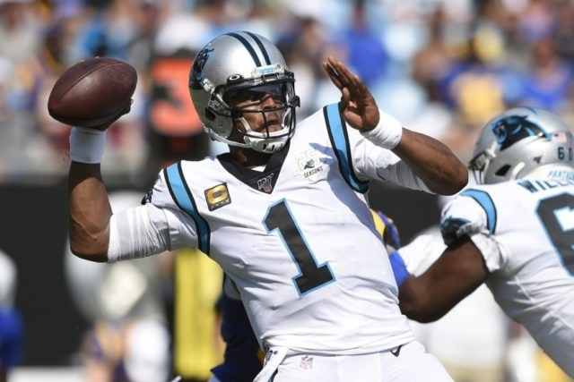 In this Sept. 9, 2019, file photo, Carolina Panthers quarterback Cam Newton looks for a receiver during the team's NFL football game against the Los Angeles Rams during the second half in Charlotte, N.C. The New England Patriots have reached an agreement with free-agent quarterback Newton, bringing in the 2015 …