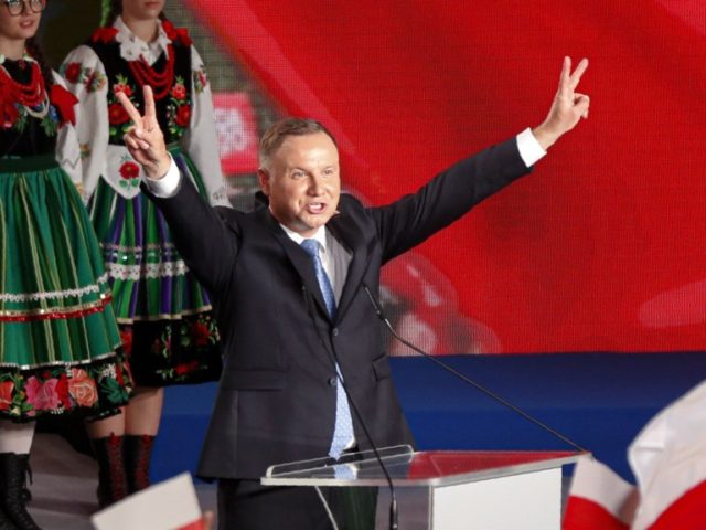 President Andrzej Duda flashes victory signs after voting ended in the presidential election in Lowicz, Poland, Sunday, June 28, 2020. The election will test the popularity of incumbent President Andrzej Duda, who is seeking a second term, and of the conservative ruling party that backs him. Exit poll shows incumbent …