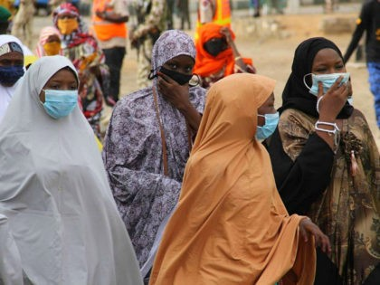 Female worshippers wear face masks as they arrives at Ramat Square Eid grounds in Maiduguri ahead of the Eid al-Fitr prayer on May 24, 2020. (Photo by Audu MARTE / AFP) (Photo by AUDU MARTE/AFP via Getty Images)