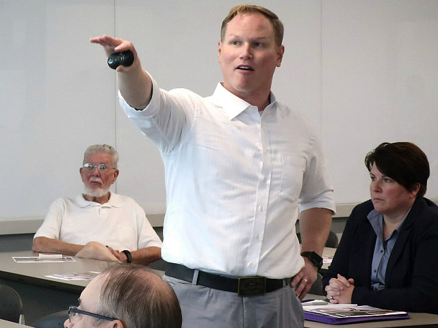 FILE - In this Aug. 26, 2019, file photo, U.S. Rep. Steve Watkins, R-Kan., makes a point during a town hall meeting, in Topeka, Kan. Watkins, a freshman Kansas congressman who had listed a UPS Inc. store as his residence on a voter registration, was criminally charged Tuesday, July 14, …