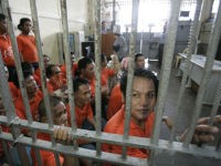 Filipino inmates wait to return to their cells as they performed with the Bureau of Corrections Orchestra and Chorale inside the social hall of the New Bilibid Prison maximum security compound in suburban Muntinlupa, south of Manila, Philippines on Tuesday June 15, 2010. Organizers said the program hopes to highlight …