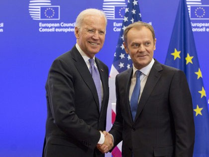 U.S. Vice President Joe Biden, left, shakes hands with European Council President Donald Tusk at the EU Council building in Brussels on Friday, Feb. 6, 2015. Biden is in Brussels on a one-day trip to meet EU and Belgian leaders. (AP Photo/Virginia Mayo)