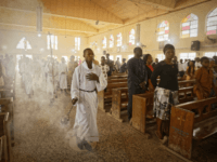 An altar boy swings the thurible of incense during a morning service at the Saint Charles Catholic Church, the site of a 2014 bomb attack blamed on Islamic extremist group Boko Haram, in the predominantly-Christian neighborhood of Sabon Gari in Kano, northern Nigeria Sunday, Feb. 17, 2019. With the leading …