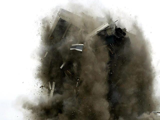 AP File Photo of building demolition by Jacqueline Larma