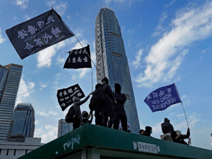 "Protesters wave flags that read ""Hong Kong Independence"" during a rally in Hong Kong, Sunday, Jan. 12, 2020. More than a thousand people attended a Sunday rally in Hong Kong to urge people and governments abroad to support the territory's pro-democracy movement and oppose China's ruling Communist Party. (AP Photo/Vincent …"