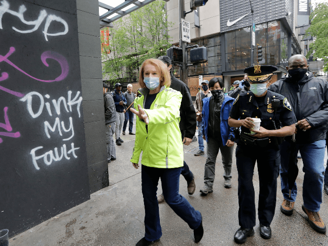 Seattle Mayor Jenny Durkan, left, surveys downtown Seattle with Police Chief Carmen Best on Sunday, May 31, 2020, following protests the night before over the death of George Floyd, a black man who was in police custody in Minneapolis. On Sunday morning, hundreds of people of all ages turned out …
