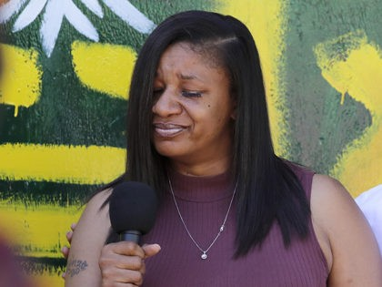 Donnitta Sinclair, mother of Lorenzo Anderson, who was killed nearby by gunfire days earlier, pauses as she talks about her son's death during a broadcast by Converge Media, Tuesday, June 23, 2020, in Seattle, where streets are blocked off in what has been named the Capitol Hill Occupied Protest zone. …