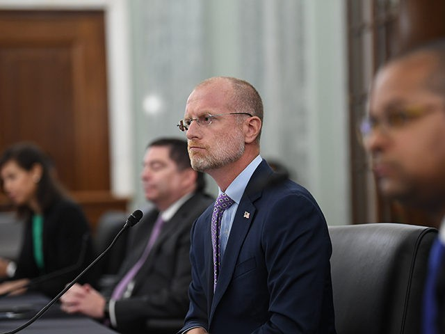 Brendan Carr listens during a Senate Commerce, Science, and Transportation committee hearing to examine the Federal Communications Commission on Capitol Hill in Washington, Wednesday, June 24, 2020. (Jonathan Newton/The Washington Post via AP, Pool)