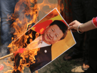 A Bharatiya Janata Party activist burns a photograph of Chinese President Xi Jinping during a protest in Jammu, India, Wednesday, July.1, 2020. Indian TikTok users awoke Tuesday to a notice from the popular short-video app saying their data would be transferred to an Irish subsidiary, a response to India's ban …