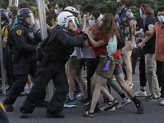 Protesters with police officers near the district attorney's office Thursday, July 9, 2020, in Salt Lake City. Two police officers in Utah were cleared earlier Thursday in the death of Bernardo Palacios-Carbajal, an armed man shot at more than 30 times as he ran from police, a decision that prompted …