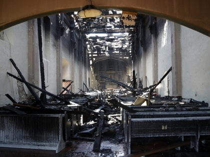 The interior of the San Gabriel Mission is damaged following a morning fire, Saturday, July 11, 2020, in San Gabriel, Calif. The fire destroyed the rooftop and most of the interior of the nearly 250-year-old California church that was undergoing renovation. (AP Photo/Marcio Jose Sanchez)