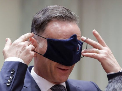 German Foreign Minister Heiko Maas puts on a face mask, to prevent the spread of coronavirus, as he attends an EU foreign ministers at the European Council building in Brussels, Monday, July 13, 2020. European Union foreign ministers meet for the first time face-to-face since the pandemic lockdown and will …