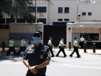 Chinese policemen march past the former United States Consulate in Chengdu in southwest China's Sichuan province on Monday, July 27, 2020. Chinese authorities took control of the former U.S. consulate in the southwestern Chinese city on Monday after it was ordered closed amid rising tensions between the global powers. (AP …
