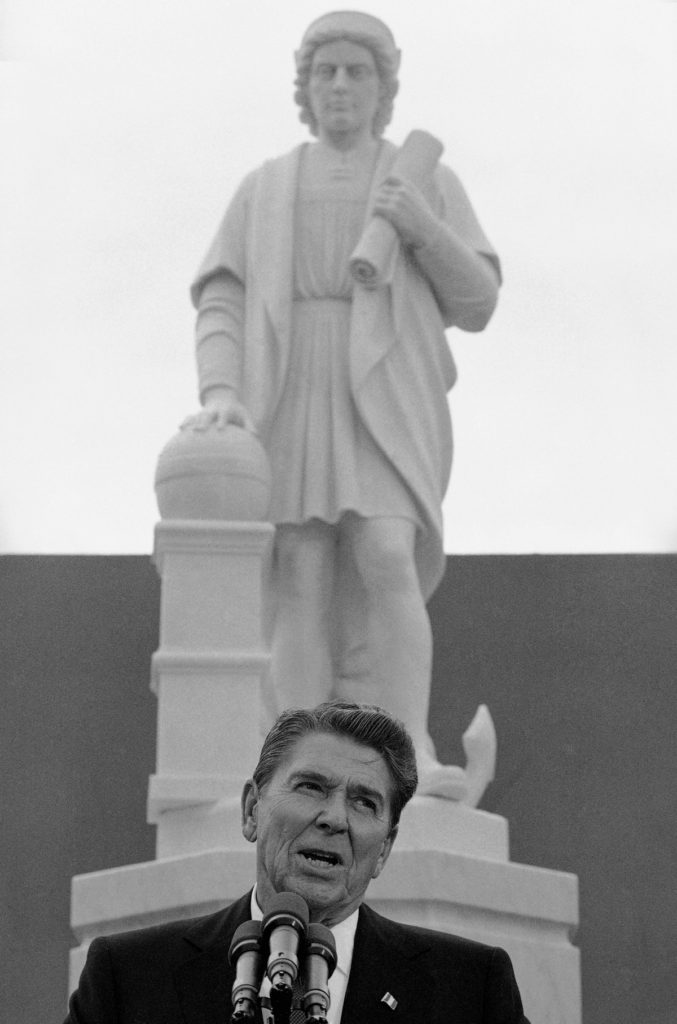 In this Monday, Oct. 9, 1984, file photo, President Ronald Reagan addresses a ceremony in Baltimore, to unveil a statue of Christopher Columbus. Baltimore protesters pulled down the statue of Christopher Columbus and threw it into the city's Inner Harbor, Saturday, July 4, 2020. (AP Photo/Lana Harris, File)