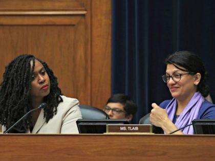 WASHINGTON, DC - JULY 25: Rep. Ayanna Pressley, (D-MA) (L), and Rep. Rashida Tlaib, (D-MI) attend a House Economic and Consumer Policy Subcommittee which is examining JUUL's role in the youth nicotine epidemic, on July 25, 2019 in Washington, DC. (Photo by Mark Wilson/Getty Images)