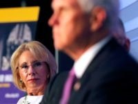 NAACP Education Secretary Betsy DeVos listens as Vice President Mike Pence speaks at a roundtable discussion in Tiger Stadium on the LSU campus in Baton Rouge, La., Tuesday, July 14, 2020. (AP Photo/Gerald Herbert)