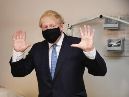 LONDON, ENGLAND - JULY 24: Prime minister Boris Johnson wears a face mask as he visits Tollgate Medical Centre in Beckton on July 24, 2020 in London, England. (Photo by Jeremy Selwyn - WPA Pool/Getty Images)