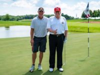 President Donald J. Trump poses for a photo with football legend Brett Favre at Trump National Golf Club in Bedminster Saturday, July 25, 2020, in Bedminster, N.J. (Official White House Photo by Tia Dufour)