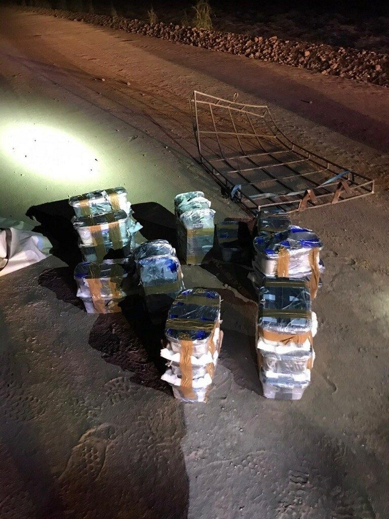 Border Patrol agents seize additional packages of methamphetamine after smugglers carried them over border in an ultralight aircraft. (Duffel bag filed with packages containing methamphetamine seized by Border Patrol.(Photo: U.S. Border Patrol/El Centro Sector)