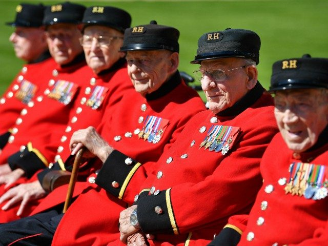 (L-R) Chelsea Pensioners who are World War Two Battle of Normandy and D-Day veterans Roy Cadman, James George, Bill Fitzgerald, Ernie Boyden, Fran Mouque and George Skipper pose for a photograph at The Royal Hospital Chelsea in London on May 13, 2019. - 2019 marks the 75th Anniversary of the …