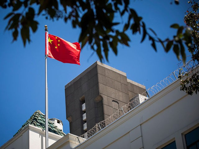 The flag of the People's Republic of China flies in the wind above the Consulate General of the People's Republic of China in San Francisco, California on July 23, 2020. - The US Justice Department announced July 23, 2020 the indictments of four Chinese researchers it said lied about their …