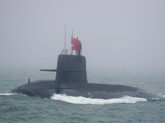 A Great Wall 236 submarine of the Chinese People's Liberation Army (PLA) Navy, billed by Chinese state media as a new type of conventional submarine, participates in a naval parade to commemorate the 70th anniversary of the founding of China's PLA Navy in the sea near Qingdao, in eastern China's …