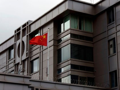 The Chinese flag flies outside of the Chinese consulate in Houston after the US State Department ordered China to close the consulate in Houston, Texas, July 22, 2020. - US-Chinese tensions, already rising because of the coronavirus pandemic and crackdown in Hong Kong, ratcheted up another notch on Wednesday as …