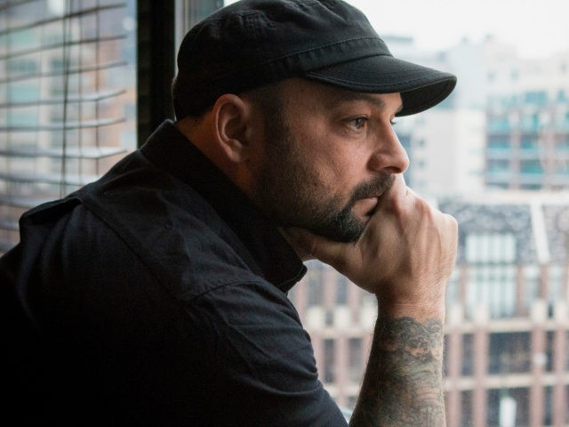 In this Jan. 9, 2017, photo, Christian Picciolini, founder of the group Life After Hate, poses for a photograph in his Chicago home. Picciolini, a former skinhead, is an activist combatting what many see as a surge in white nationalism across the United States. He's doing it by helping members …