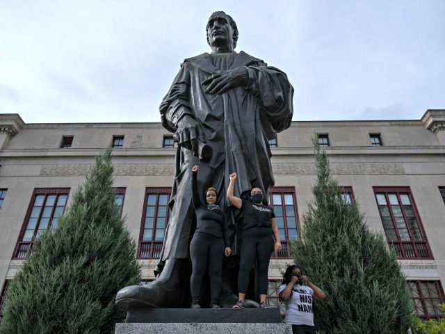 A statue of Christopher Columbus was removed from in front of City Hall in Columbus, Ohio, on Wednesday. The statue has been a focal point for racial justice protests; earlier this week, demonstrators climbed onto its pedestal to pose for photos. Image: Seth Herald/AFP via Getty Images
