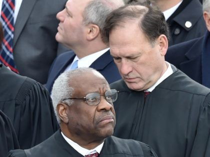 Clarence Thomas and Samuel Alito (Paul J. Richards / AFP / Getty)