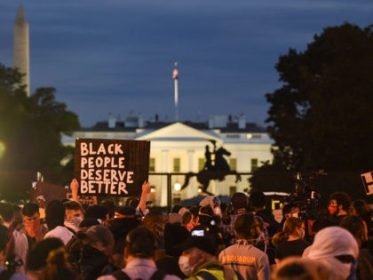 Demonstrators protests the death of George Floyd near Lafayette Square across the White House on June 2, 2020 in Washington, DC.D - Anti-racism protests have put several US cities under curfew to suppress rioting, following the death of George Floyd in police custody. (Photo by ANDREW CABALLERO-REYNOLDS / AFP) (Photo …