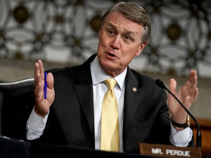 WASHINGTON, DC - MAY 06: Sen. David Perdue (R-GA) asks questions during a Senate Armed Services Committee hearing to discuss the national security impact of the Federal Communications Commissions L-band spectrum approval to Ligado Networks on Capitol Hill on May 6, 2020 in Washington, DC. (Photo by Greg Nash - …
