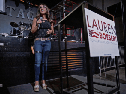 Businesswoman Lauren Boebert speaks during a watch party at Warehouse 25 Sixty Five in Grand Junction, Colo., after polls closed in Colorado's primary election on Tuesday, June 30, 2020. Boebert, a pistol-packing restaurant owner who has expressed support for a far-right conspiracy theory has upset five-term Colorado U.S. Rep. Scott …