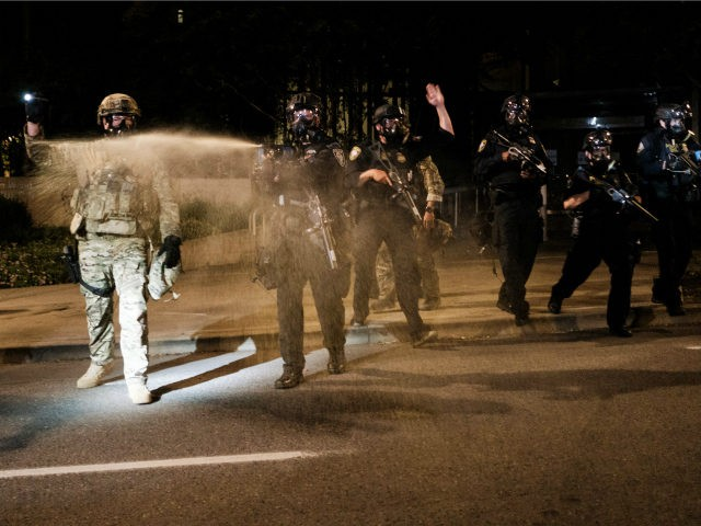 Federal officers use tear gas and other crowd dispersal munitions on protesters outside the Multnomah County Justice Center on July 17, 2020 in Portland, Oregon. Federal law enforcement agencies attempt to intervene as protests continue in Portland. (Photo by Mason Trinca/Getty Images)