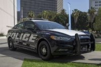 A hybrid police car is seen at the unveiling of two Ford Fusion hybrid pursuit-rated Police Responder cars at Los Angeles Police Department headquarters on April 10, 2017 in Los Angeles, Calif.David McNew / Getty Images file July 10, 2020, 8:38 AM PDT