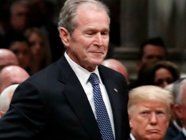 Former President George W. Bush walks past President Donald Trump to speak a State Funeral for President George H.W. Bush, at the National Cathedral, Wednesday, Dec. 5, 2018, in Washington. (AP Photo/Alex Brandon