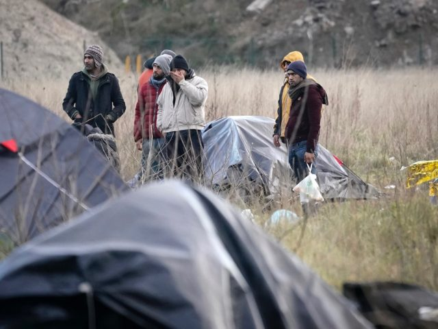 CALAIS, FRANCE - JANUARY 08: Migrants move their belongings as French police clear a migrant camp near Calais Port on January 08, 2019 in Calais, France. In recent weeks there has been an increase in migrants, many claiming to be from Iran, making the sea crossing from France to the …
