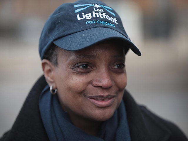 CHICAGO, ILLINOIS - APRIL 02: Chicago mayoral candidate Lori Lightfoot greets commuters at an L station in Logan Square on April 02, 2019 in Chicago, Illinois. Voters in Chicago go to the polls today to select a new mayor in a runoff election. Lightfoot is running against Cook County Board …