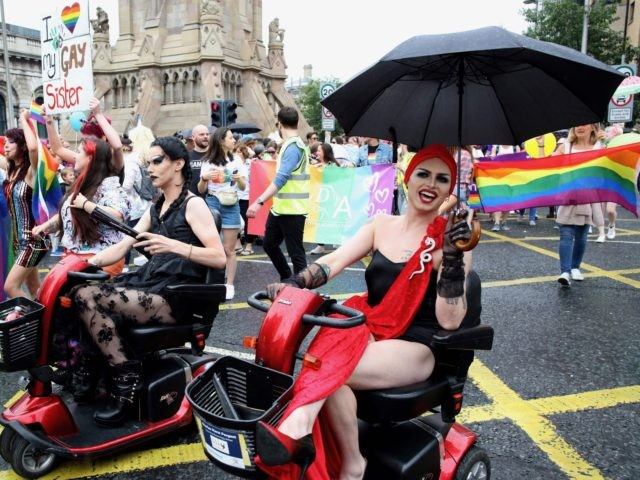Members of the Lesbian, Gay, Bisexual and Transgender (LGBT) community and supporters take part in the Belfast Pride Parade 2019 in Belfast, Northern Ireland on August 3, 2019. - Northern Ireland's LGBT community take to the streets of Belfast in Pride celebrations buoyed by the promise that same-sex marriage rights …