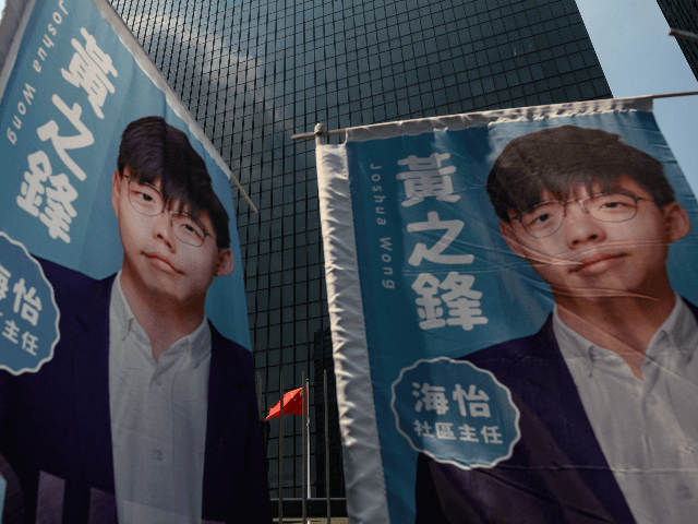 Banners of pro democracy activist and South Horizons Community Organiser Joshua Wong are placed in front of the Central Government Complex during the announcement of his run for 2019 District Council elections in Hong Kong on September 28, 2019 (Photo by Philip FONG / AFP) (Photo credit should read PHILIP …