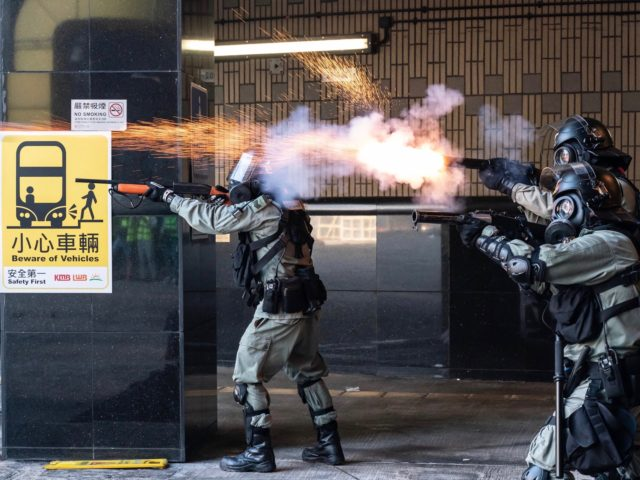 HONG KONG, CHINA - NOVEMBER 18: Riot police fire teargas and rubber bullets as protesters attempt to leave The Hong Kong Poytechnic University on November 18, 2019 in Hong Kong, China. Anti-government protesters armed with bricks, firebombs, and bows and arrows fought with the police at university campuses over the …