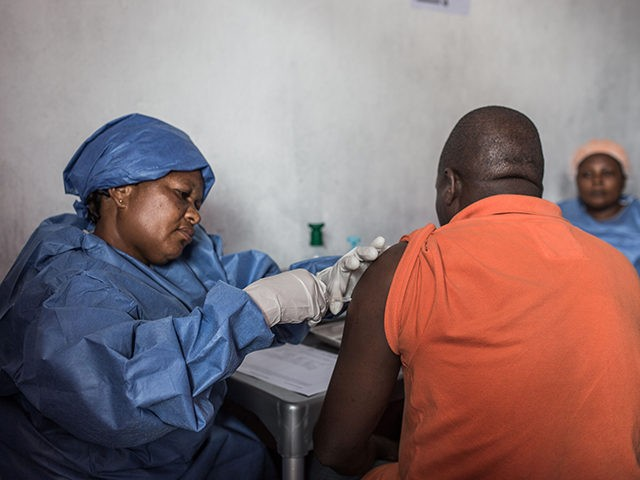 A man is getting inoculated with an Ebola vaccine on November 22, 2019 in Goma. (Photo by PAMELA TULIZO / AFP) (Photo by PAMELA TULIZO/AFP via Getty Images)