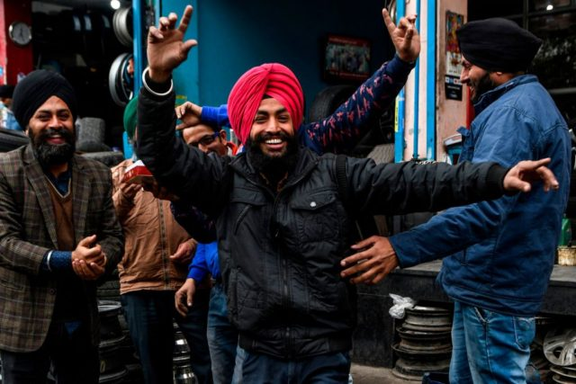 Sikh refugees from Pakistan andAfghanistan celebratethe approval of the government's Citizenship Amendment Bill (CAB) in Amritsar on December 12, 2019. - Indian police fired blanks on December 12 as thousands of protesters ignored a curfew in the north-east of the country, in a fresh day of demonstrations against contentious new …