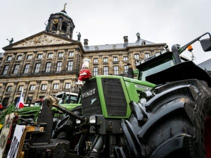 Tractors are parked on the Dam Square in Amsterdam on December 13, 2019 during a protest against what farmers consider to be unrealistic nitrogen emissions measures by the provincial government. (Photo by Remko DE WAAL / ANP / AFP) / Netherlands OUT (Photo by REMKO DE WAAL/ANP/AFP via Getty Images)