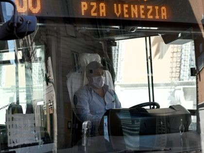 A driver wearing a protection steers a public transport bus on Via del Corso in central Rome on March 12, 2020, as Italy shut all stores except for pharmacies and food shops in a desperate bid to halt the spread of a coronavirus. (Photo by Vincenzo PINTO / AFP) (Photo …