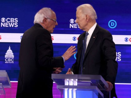 CHARLESTON, SOUTH CAROLINA - FEBRUARY 25: Democratic presidential candidates Sen. Bernie Sanders (I-VT) and former Vice President Joe Biden speak during a break at the Democratic presidential primary debate at the Charleston Gaillard Center on February 25, 2020 in Charleston, South Carolina. Seven candidates qualified for the debate, hosted by …