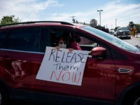 Protesters drive in a caravan around Immigration and Customs Enforcement El Paso Processing Center to demand the release of ICE detainees due to safety concerns amidst the COVID-19 outbreak on April 16, 2020 in El Paso, Texas. - One detainee has already tested positive in the nearby Otero County Processing …