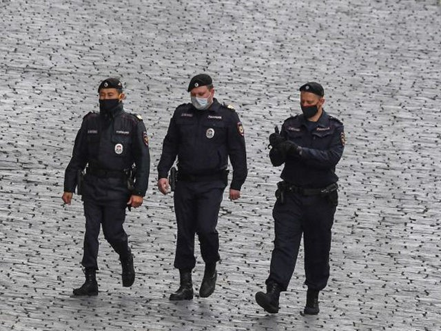 Russian police wearing face masks patrol in central Moscow on May 17, 2020, during a strict lockdown in Russia to stop the spread of the novel coronavirus COVID-19. (Photo by Yuri KADOBNOV / AFP) (Photo by YURI KADOBNOV/AFP via Getty Images)
