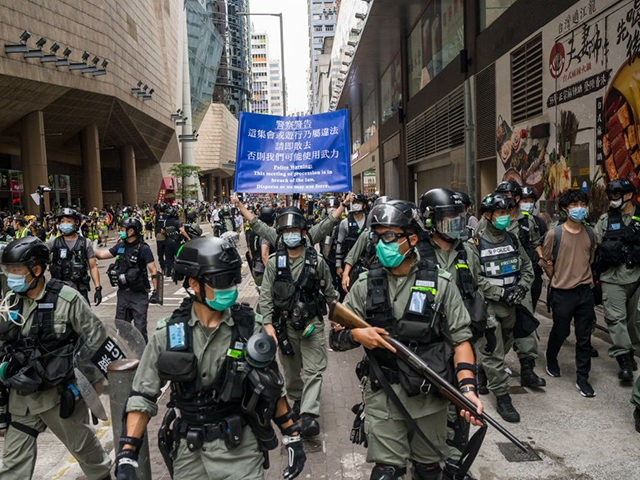 HONG KONG, CHINA - MAY 27: Riot police stand guard during a protest against a planned national security law at Admiralty district on May 27, 2020 in Hong Kong, China. Chinese Premier Li Keqiang said on Friday during the National People's Congress that Beijing would establish a sound legal system …